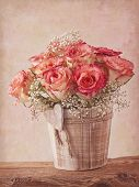 Pink roses on wooden desk