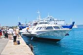 CORFU, GREECE - JUNE 23, 2014: Joy Cruises hydrofoil Ilida II disembarks passengers from Paxos at Ke