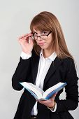 Young Female With A Book And Glasses
