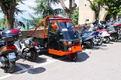 Motorcycle On The Parking Lot In The Fortress Of San Marino.
