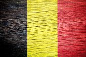 Belgium flag on old wood texture