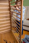 Kid assembling cot for a newborn at home