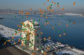 Balloons on the background of the Moscow Gates in the sunny winter day. Irkutsk