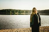 picture of gothic hair  - unusual gothic girl with long red hair reflects at the lake - JPG
