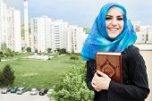 picture of hijabs  - beautiful muslim woman wearing hijab and holding holy book Koran - JPG