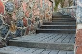 stock photo of stepping stones  - tortuous ascent of stone steps between the stone walls - JPG