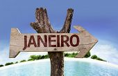 January (in Portuguese) sign with a beach on background