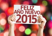Happy New Year 2015 (In Spanish) card with colorful background with defocused lights