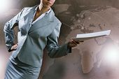 Close up of businesswoman with papers in hands