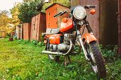 Vintage Red Motorcycle Generic Motorbike In Countryside