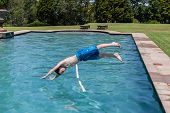 Boy Diving Pool Summer