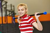 Young woman training exercises with training stick in fitness club gym