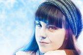 Young Sensual Brunette Woman Wearing Winter Hat Over Winter Cold Background