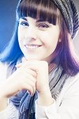 Portrait Of Smiling And Happy Caucasian Girl In Winter Long Hat In Studio Environment