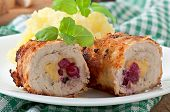 Chicken rolls with cranberries, cheese and honey with garnish of mashed potatoes