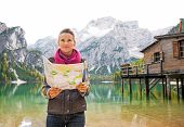 stock photo of south tyrol  - Young woman with map on lake braies in south tyrol italy - JPG