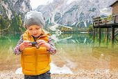 Child Checking Photos In Camera On Lake Braies In South Tyrol, I