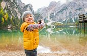 foto of south tyrol  - Happy child taking photo of lake braies in south tyrol italy - JPG