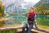 foto of south tyrol  - Portrait of happy young woman on lake braies in south tyrol italy - JPG