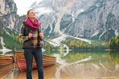 stock photo of south tyrol  - Relaxed young woman on lake braies in south tyrol italy