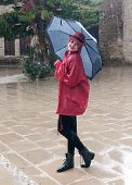 Woman In The Rain With An Umbrella