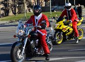 BELGRADE, SERBIA - DECEMBER 27:  Undefined Santas delivering humanitarian aid in form of gifts to disabled children during annual Santa Claus Motorcycle Parade on 27 December 2014 in Belgrade, Serbia