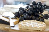 cheese choice with dark grapes