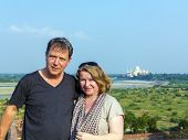 Caucasian Couple In Love With Taj Mahal In Background