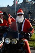 BELGRADE, SERBIA - DECEMBER 27:  Undefined Santa delivering humanitarian aid in form of gifts to disabled children during annual Santa Claus Motorcycle Parade on 27 December 2014 in Belgrade, Serbia