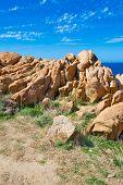 Orange Rocks By The Sea