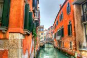 Narrow Canal In Venice Under A Gray Sky