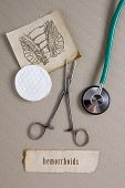 foto of anal  - Subject hemorrhoids drawing on old paper anal opening clip and stethoscope - JPG