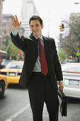 Businessman Hailing a Taxi