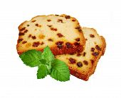 Two Pieces Of Fruitcake And Green Mint