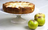 foto of pie-in-face  - Homemade italian baked apple pie over a white table - JPG