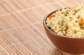 Rice With Vegetables In A Ceramic Bowl On A Mat Bamboo