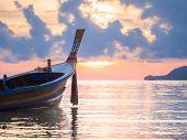 Long tailed boat  Ruea Hang Yao at sunrise in Phuket Thailand