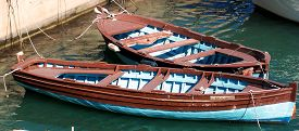 stock photo of sloop  - Two old wooden boats on the berth - JPG