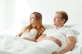 foto of matinee  - Couple lying together in bed and watching sun rising - JPG