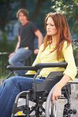 image of rollator  - lonely girl is sitting on a wheelchair on the street - JPG