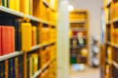 foto of academia  - Unfocused Blurred Background Of Old Vintage Books On A Wooden Shelfs In Library - JPG