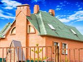 image of chimney  - chimney on the roof of the house against the blue sky - JPG