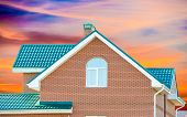 stock photo of chimney  - chimney on the roof of the house against the blue sky - JPG