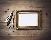 picture of barber  - Picture Frame And Vintage Barber Tools on the wood - JPG