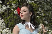 image of dogwood  - stylish pin up girl with a blooming dogwood tree in the spring - JPG