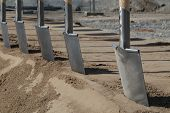 stock photo of spade  - A number of spades in a groundbreaking ceremony of a new building - JPG