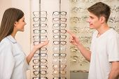 picture of optical  - Optical store client man and professional specialist help to choose - JPG