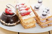 image of chocolate spoon  - selection of fresh cream napoleon and chocolate mousse cake dessert plate - JPG