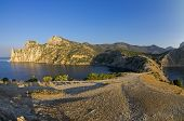 stock photo of early morning  - Small bay on the Black Sea coast in the early quiet morning - JPG