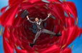 picture of dangerous situation  - Businessman falls into abyss - JPG